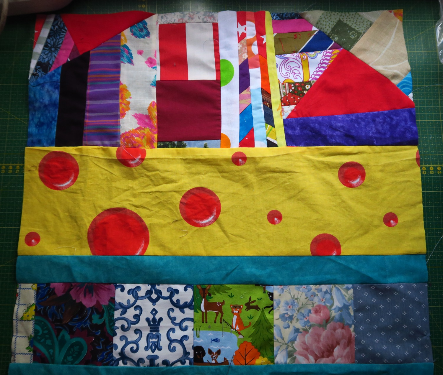 "This was my center piece. However, I didn't like all that yellow in one place, so I ended up chopping it up a bit more as I continued to add to it. Maybe you can ""find the center"" in the finished quilt!"