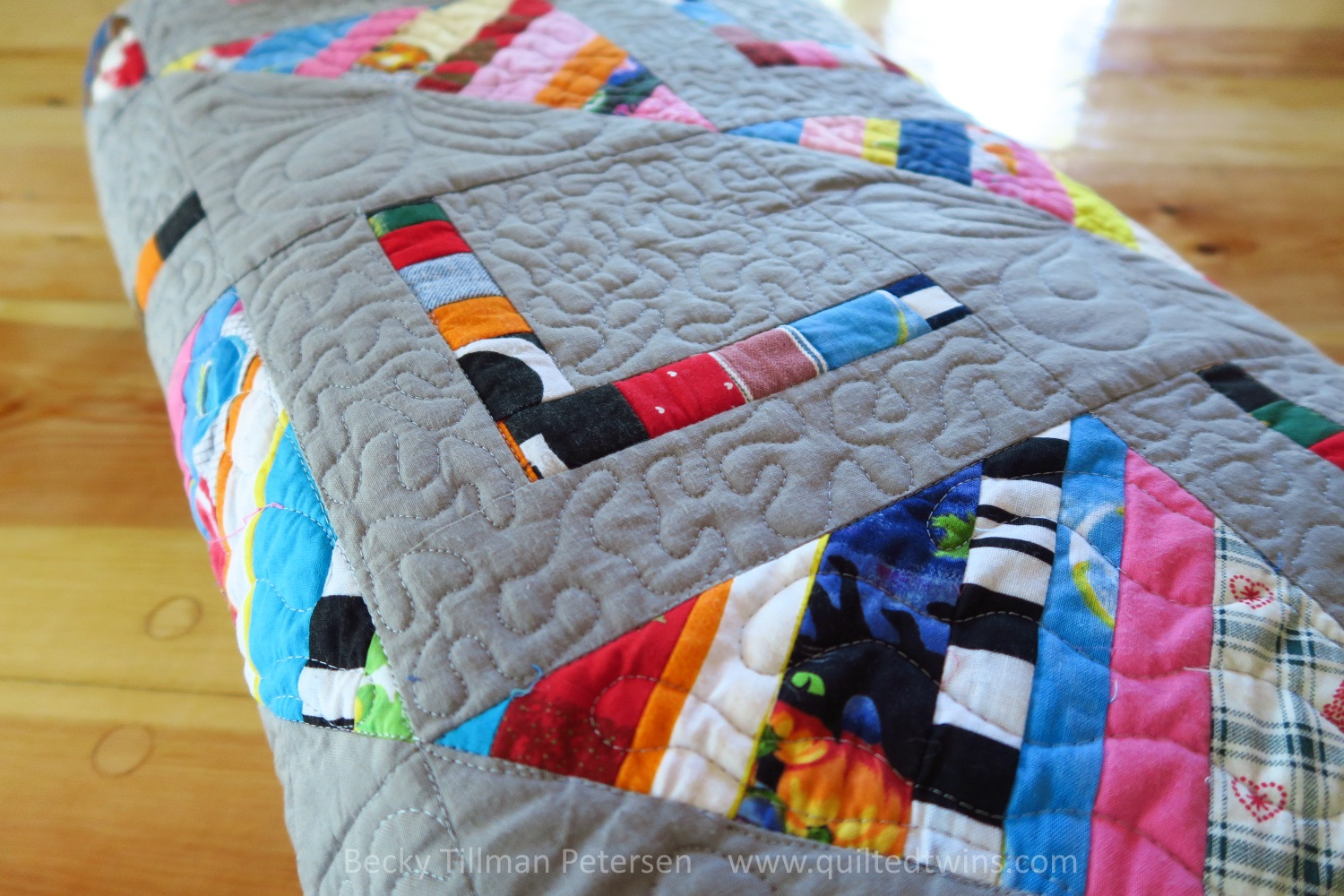 """My goal was to make the """"L"""" or the """"chair"""" kind of puff out by leaving it un-quilted and making the quilting around it almost a micro stippling. I was feeling pretty crazy when I decided on that!"""