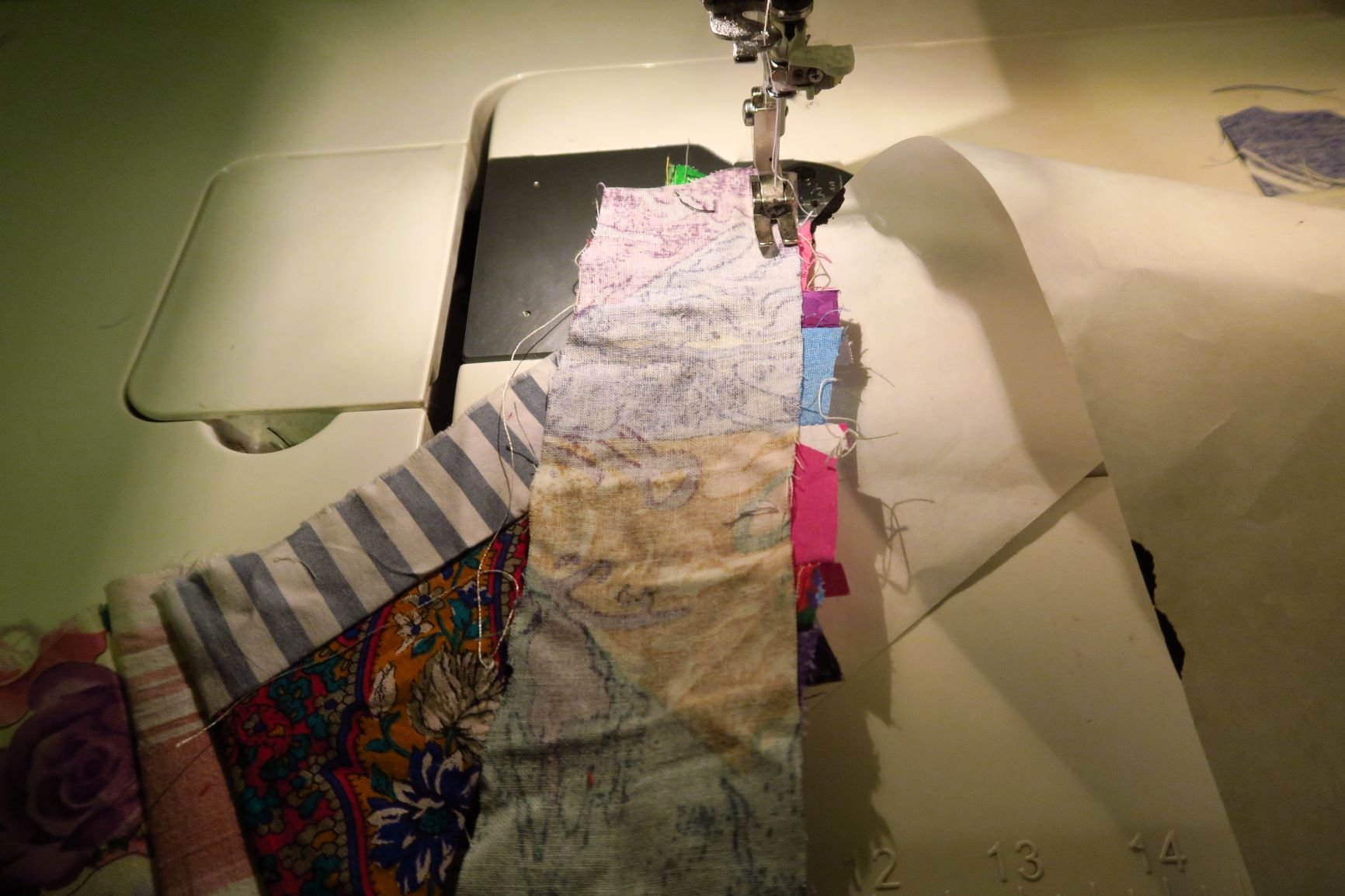 Add another strip and make the seam allowances big enough to catch the uneven places underneath.