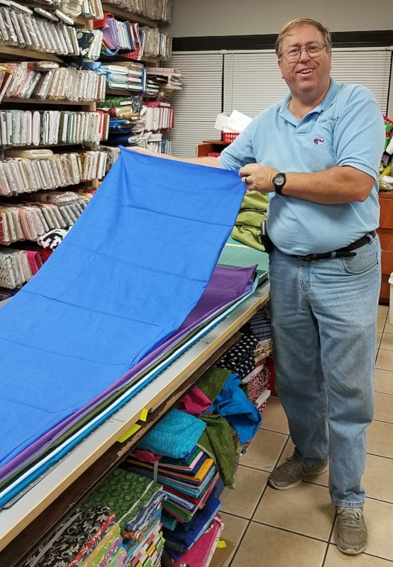 Ken, Rachael's husband, willingly held up the fabric so we could see it better!