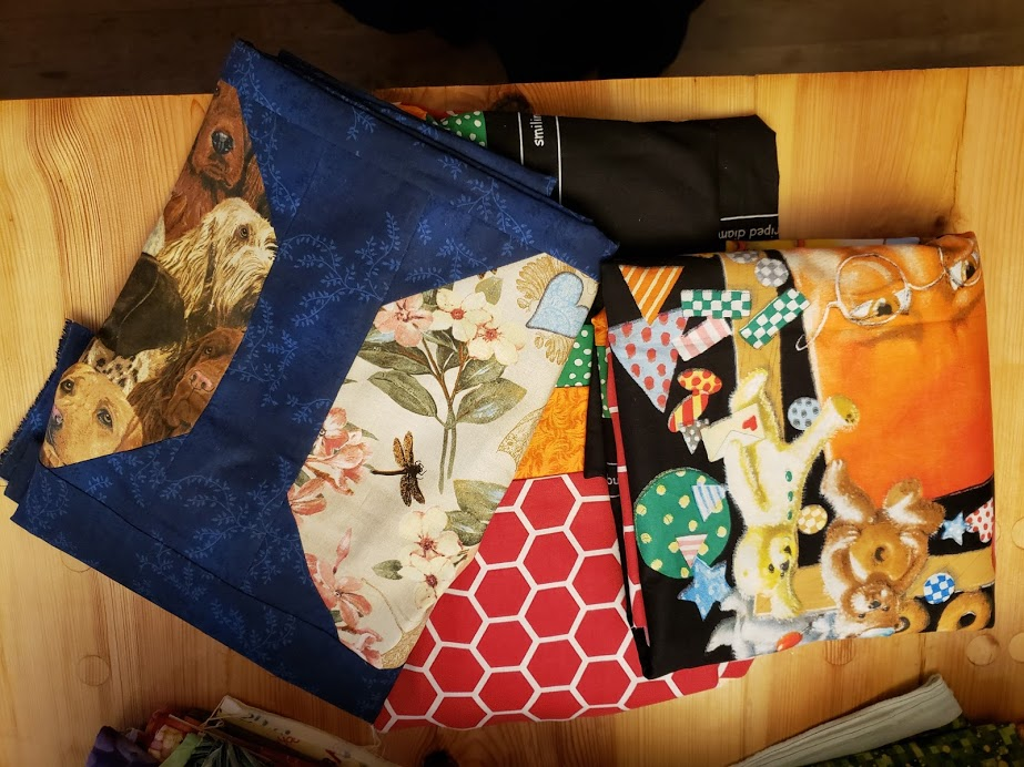 To the left is my snowball quilt I spy top and the others are panels I added borders to. I wanted to get them quilted but didn't make it.