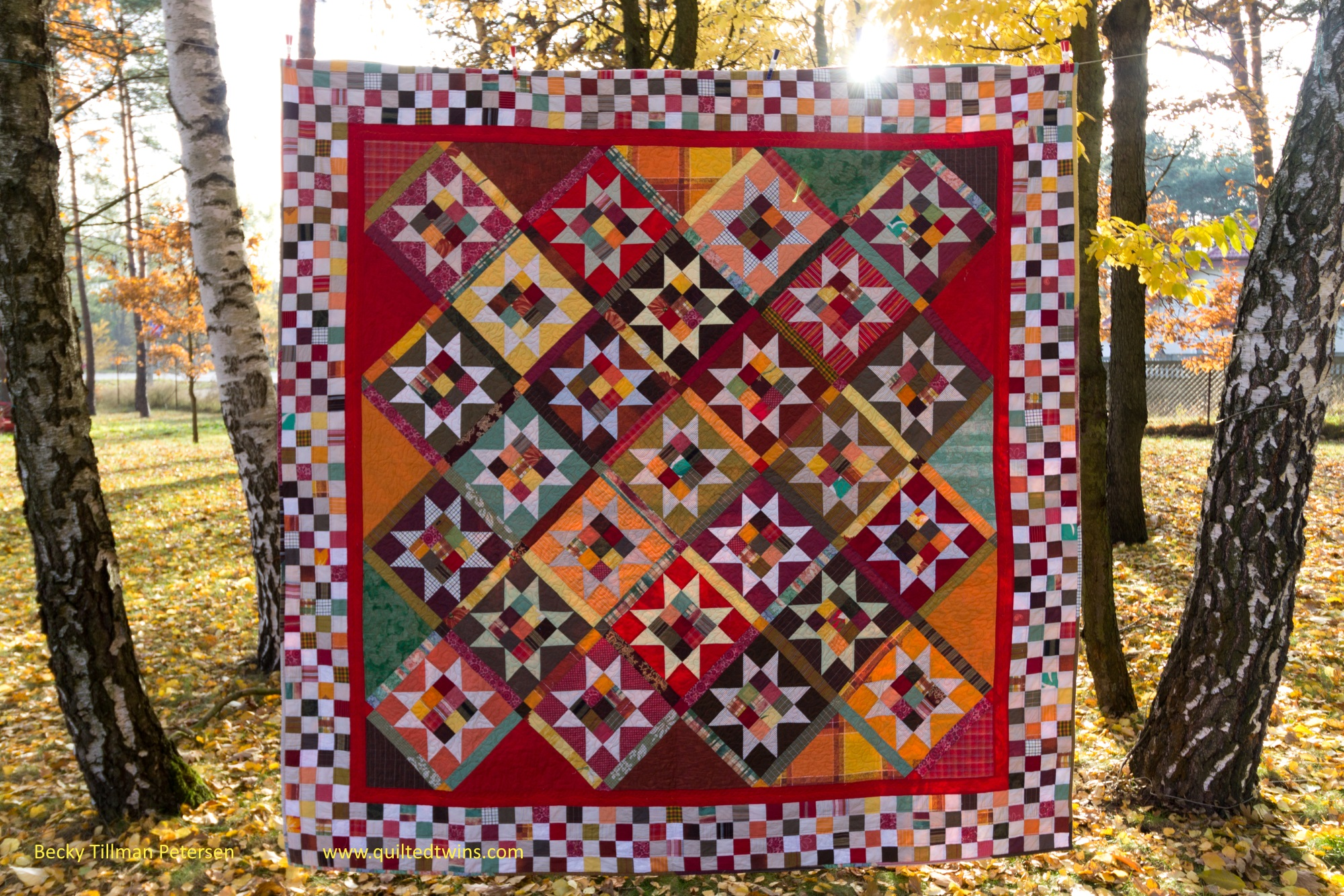 Design - mine  Inspired by - a challenge by Pat Sloan to make a top with the star block. I put it in this layout, reversed the colors, used a scrappy sashing, and added a checkerboard border for a look all my own.  Regrets - this 100% upcycled quilt was made using what I had - and I don't have any regrets with my fabric choices for this one.