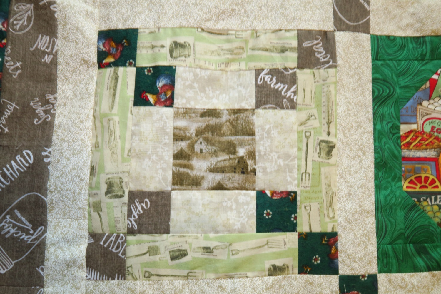 """The garden utensils fabric - I thought it was incredibly cute. I brought some back with me intending to somehow incorporate it into the quilt! It definitely reads as a """"light"""" from a distance, so I used it instead of another cream/off white."""