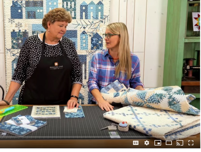 """About 1 minute into the tutorial Edyta references using leftover blues from the BOM that they are selling to making this quilt. I liked it and decided to make a double 9 patch as a result of seeing this. I would have liked to have used 1.5"""" strips, but I didn't - I made mine from 2"""" strips so the blocks are bigger."""