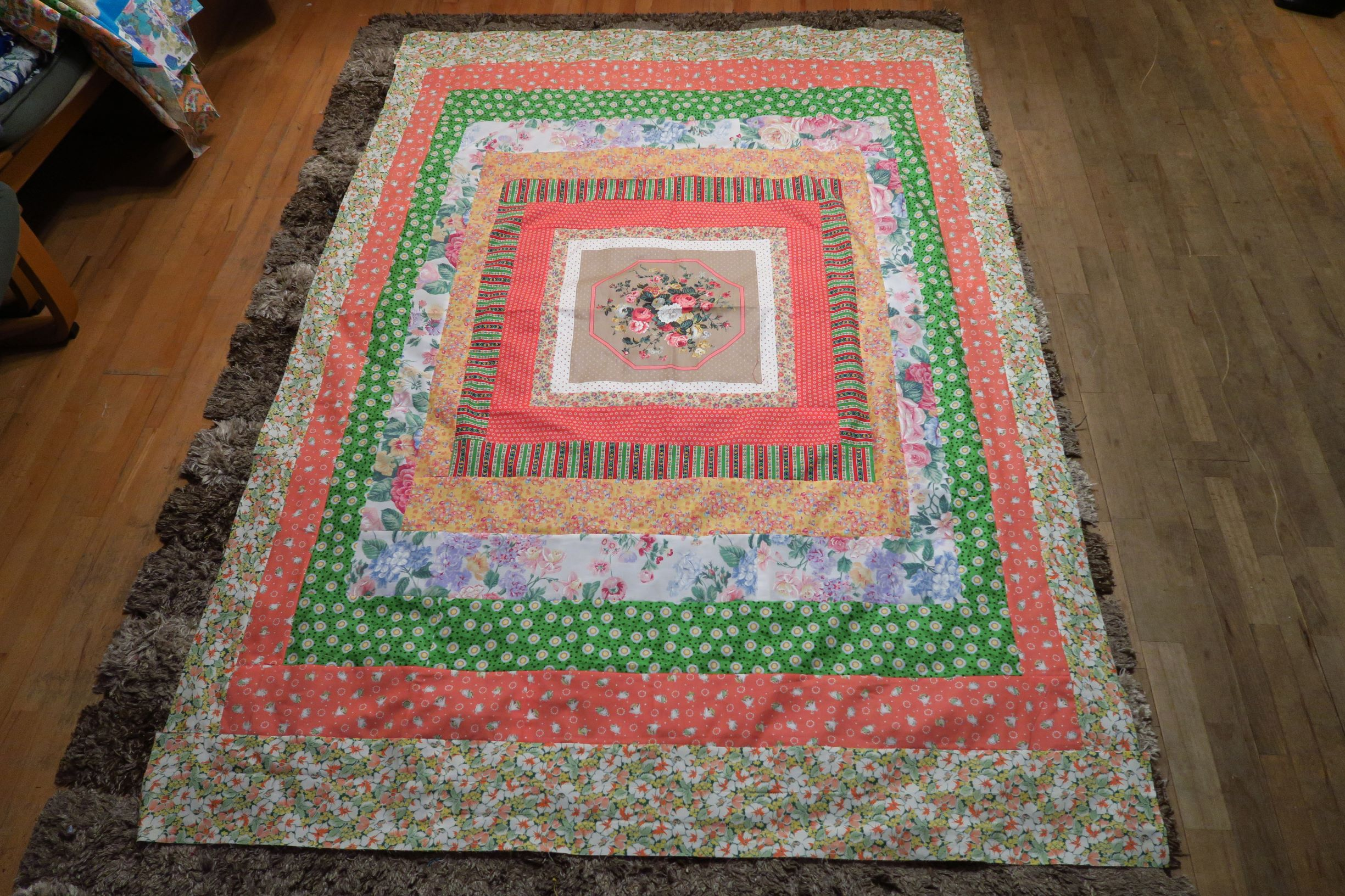 I am calling this style my Around and Round quilts  I just put borders on around the panels.