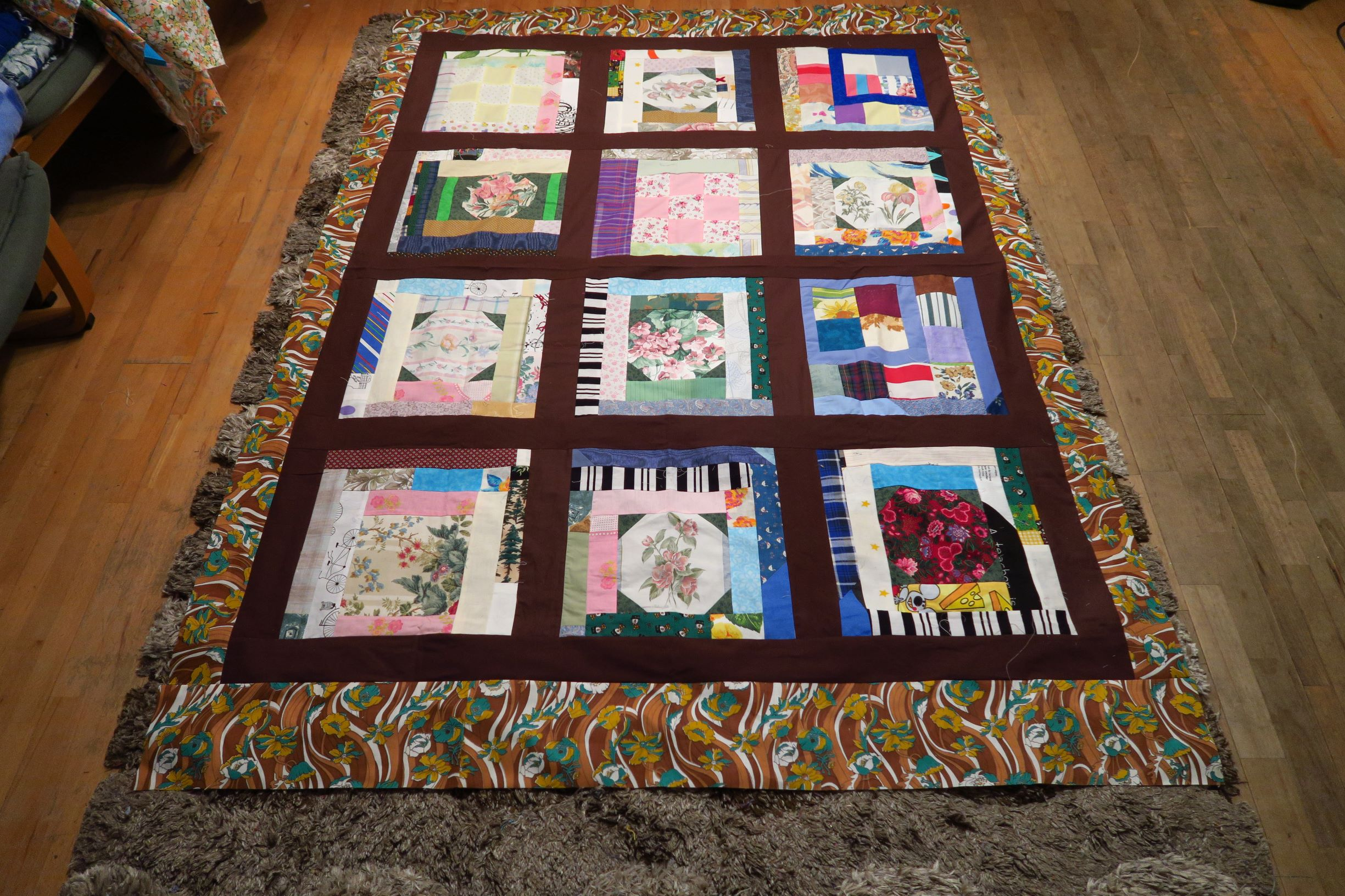 I made this crazy scrap quilt top a while ago, but added a wild border