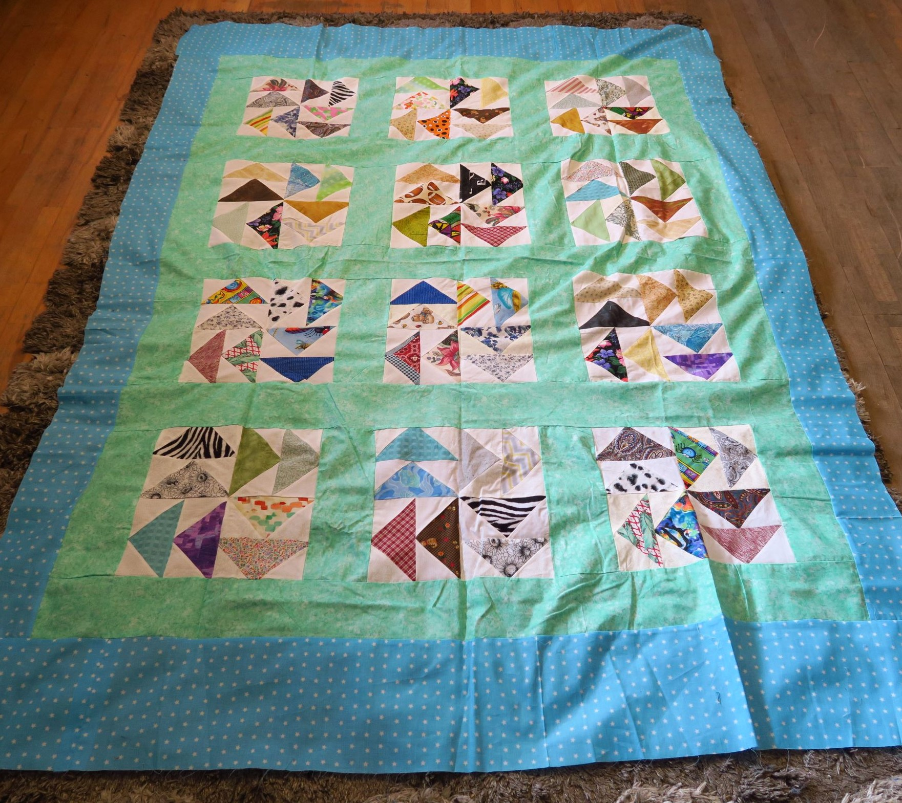 The center was donated by someone in the Quilted Twins facebook group! Thanks! I added the border