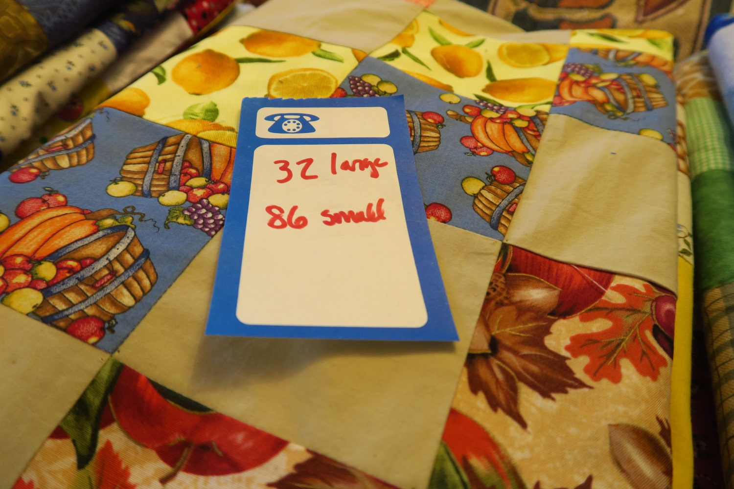 If you are good at adding, you can read and figure out that this is 118. I am so close to 120, it isn't funny! But the problem is, I've kind of set my mind on making 12 of those shadow quilts using solids. Guess I'll go over the 120 goal for his year.  What I'll do is just finish 120 and save the other finished tops til next year. I refuse to allow myself to feel like I have to do more and more and more. If I'm not careful that is how I will be. I have learned to make myself abide by my goals or I will never ever feel finished.  I figured when they gave me a 3 year extension on my residency card that that meant I would finish up 360 more charity quilts for the people of Poland or Ukraine. :) It may seem like a funny way of thinking to you, but that's what I've done.  Oh, and because I only added 4 small instead of 5, it should be 87 small.