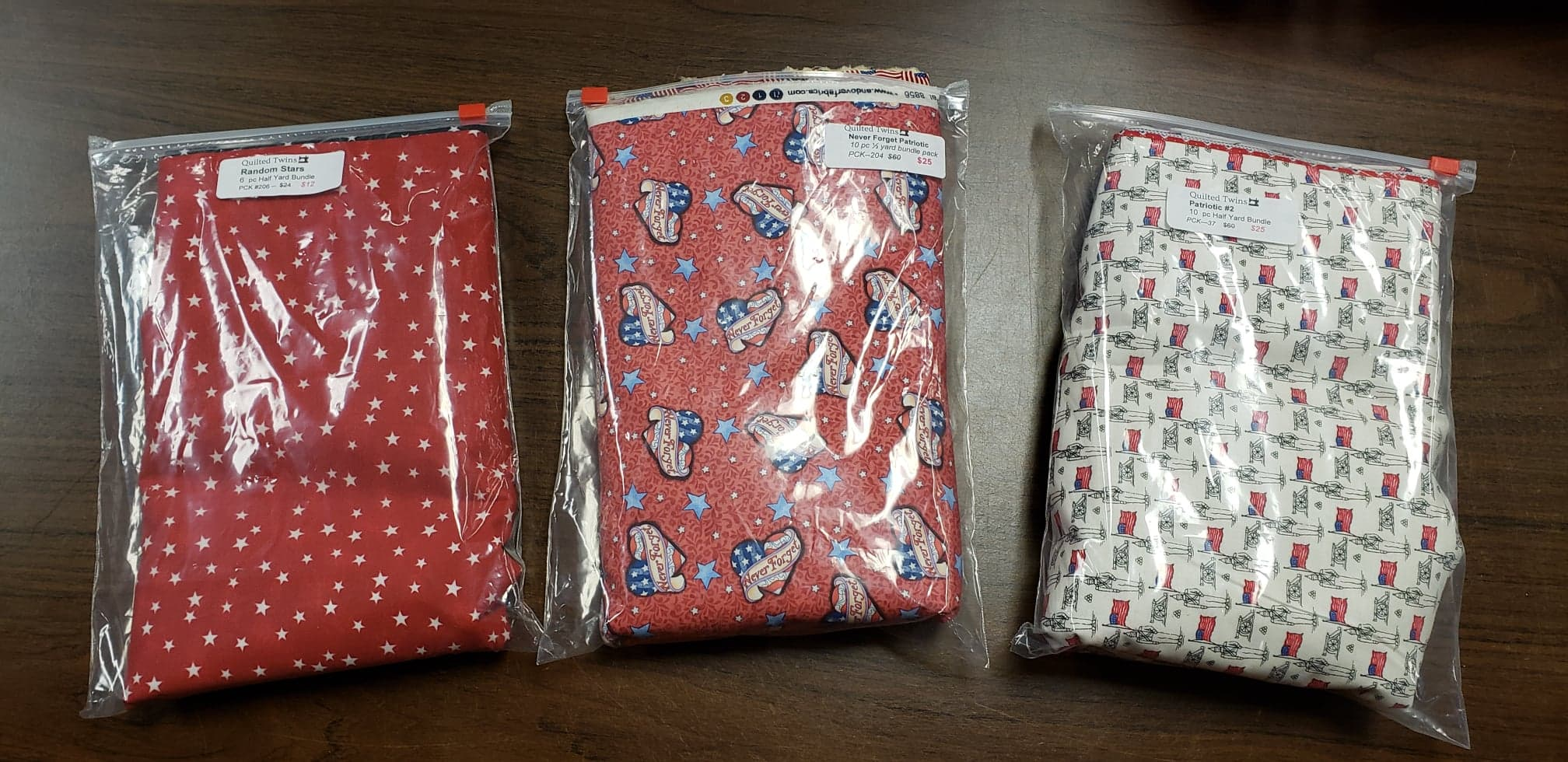 The packs are called  Random Stars ,  Never Forget Patriotic , and  Patriotic #2.  They are worth checking out. just click on the links provided and you will see a close up of the fabrics provided as well as the price.