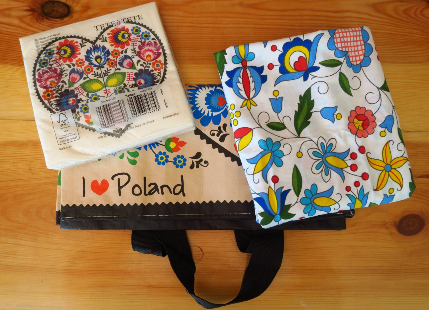 "1 A pack of 20 Polish design folk paper napkins, 2. a reusable shopping bag with ""I Love Poland"" on it and 3. a yard of 62"" wide Polish cotton fabric - folk design Kaszubski."