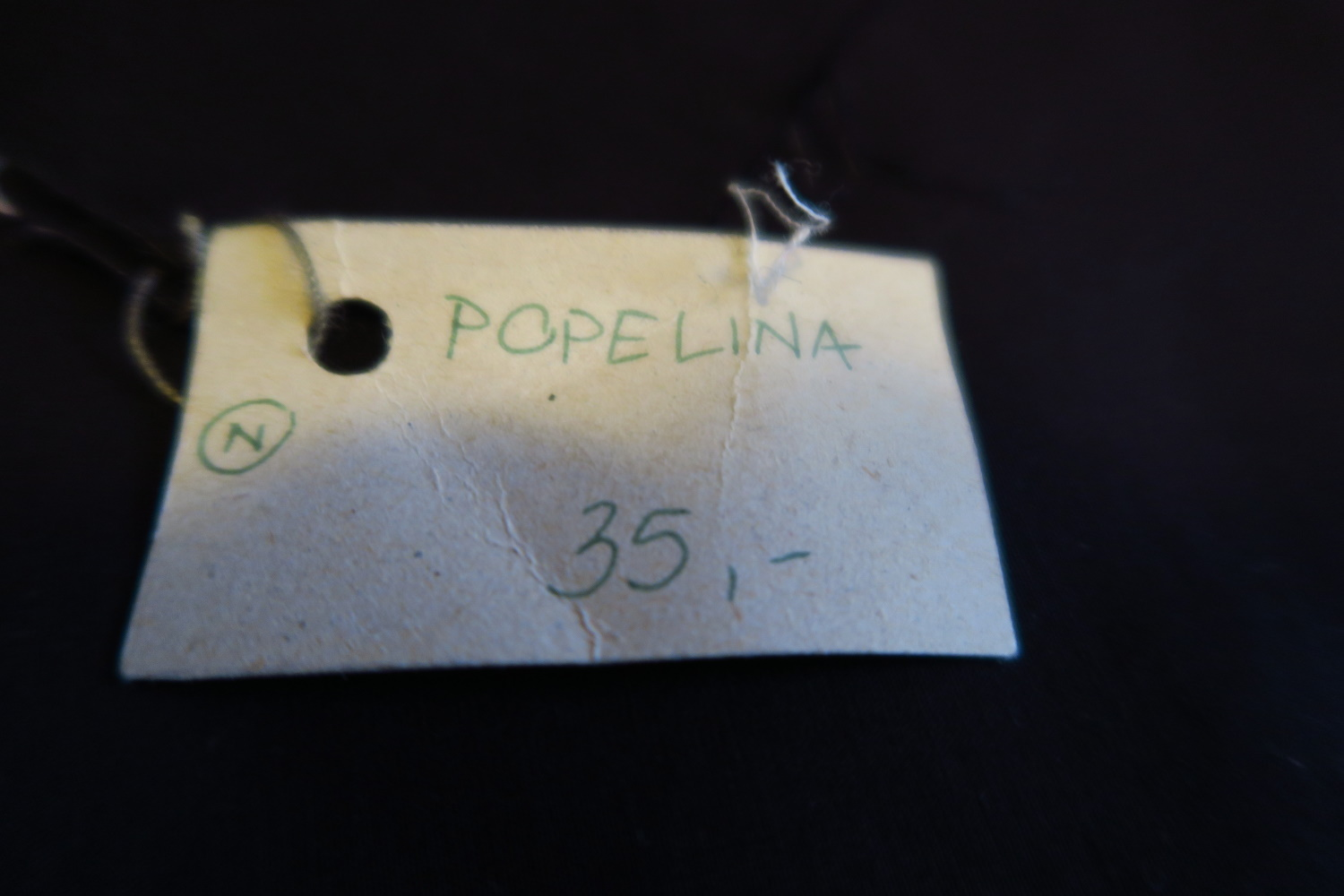 "1. Black poplin - I had 5 meters of this 60"" wide solid black poplin - all cotton from what I could tell - no fabric content on the tag. It was gone by July 20, 2019 The 35 probably meant 35 zl - though I'm not sure - maybe what they paid for it. I've got to pick up my pace. This had a really nice feel to it. Very crisp!"