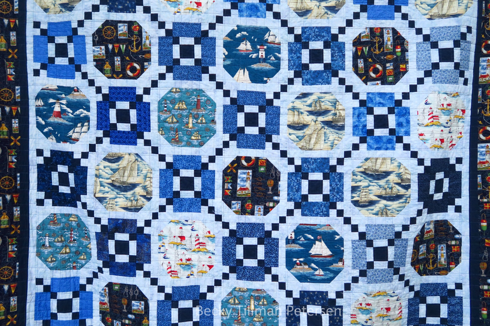 I used a bunch of different blues in this and as many of the nautical prints as I had. In many ways it's a scrap quilt - though I pulled it from my stash. They are not small scraps - different people have different definitions of what is a scrap.