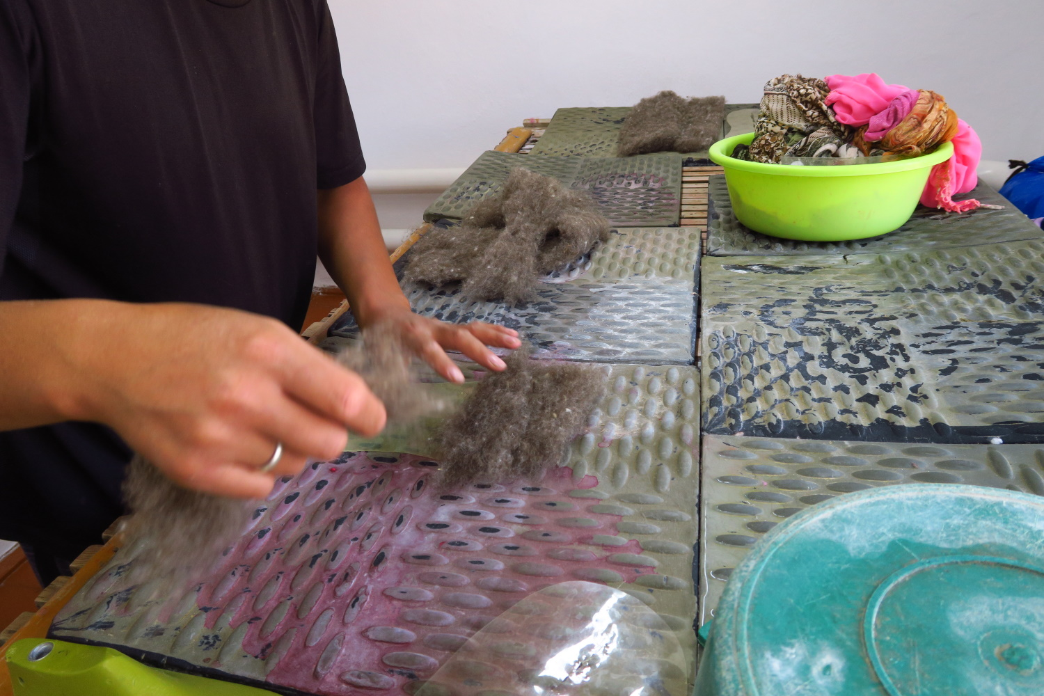 They take some pieces of that carded wool and cover the form loosely.  They completely cover the form.