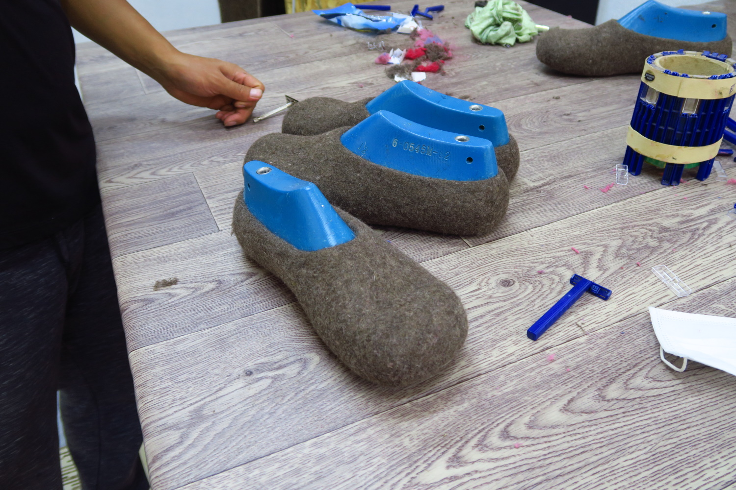 When the slippers are done, they shave them to get the little fuzzies off!