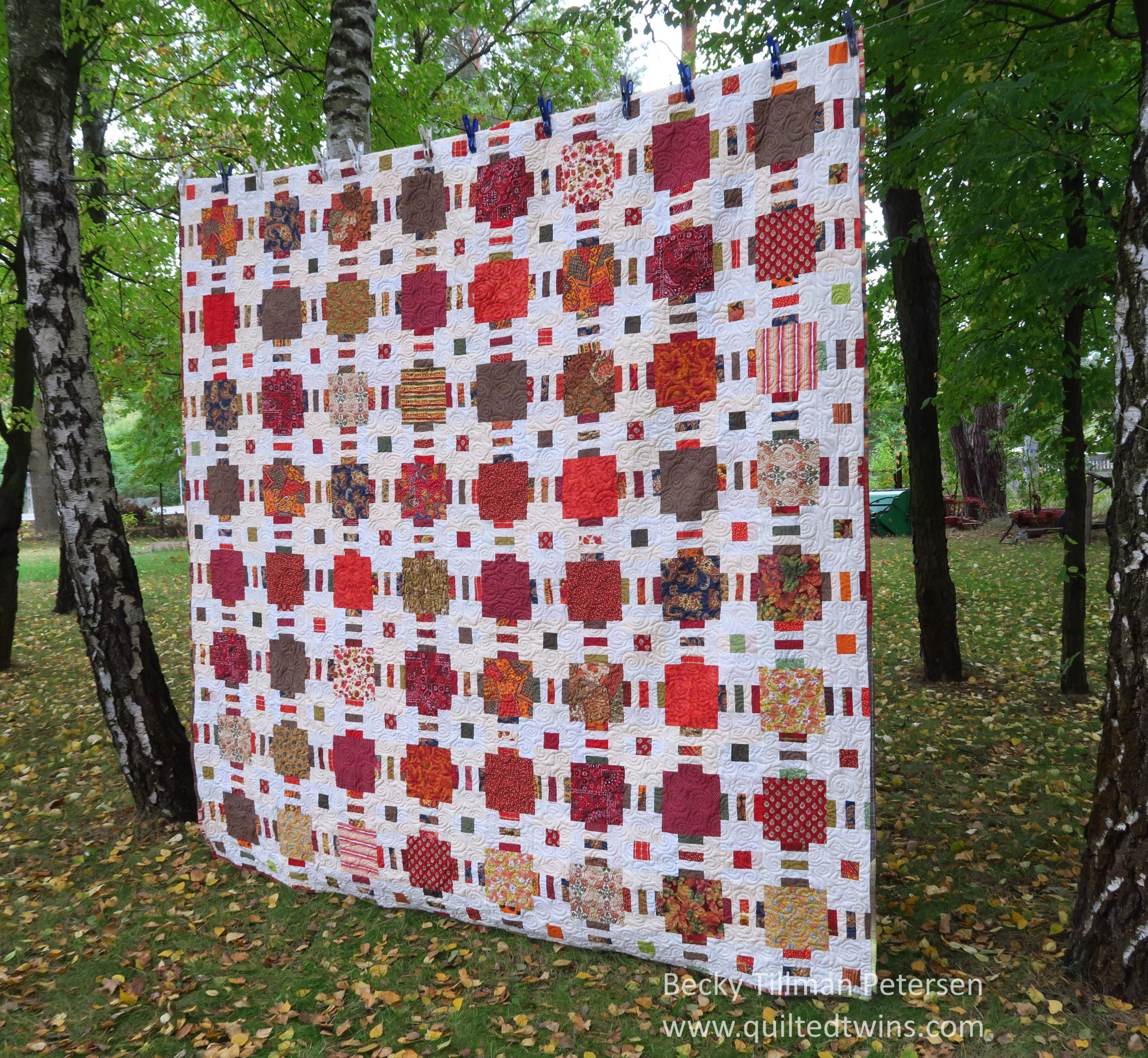 I actually wanted the picture of the quilt with the leaves on the ground. Makes it seem more like autumn!
