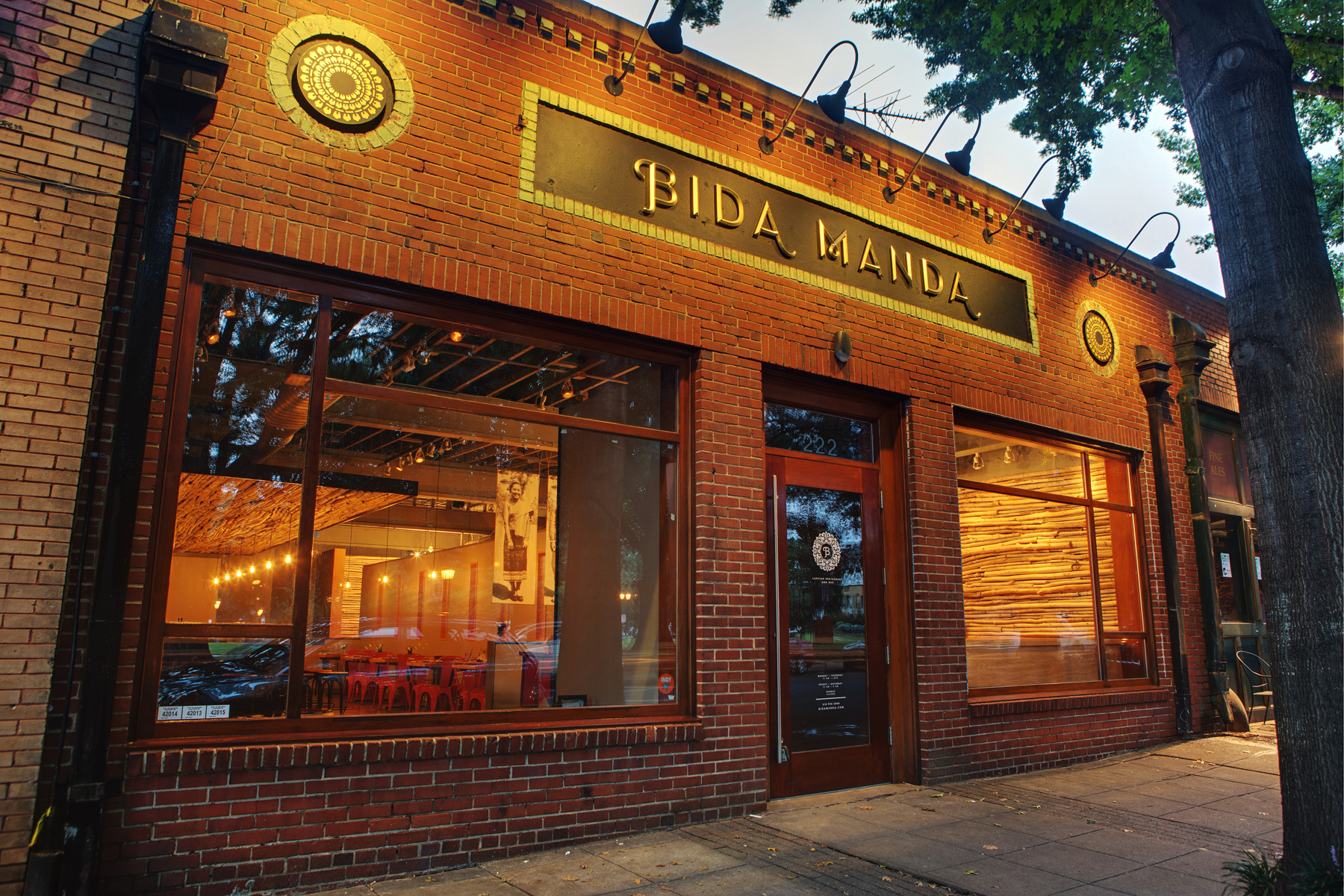 Interior, food, and principal photos of Bida Manda Laotian Restaurant and Bar in Raleigh NC. Owner Vansana Nolintha