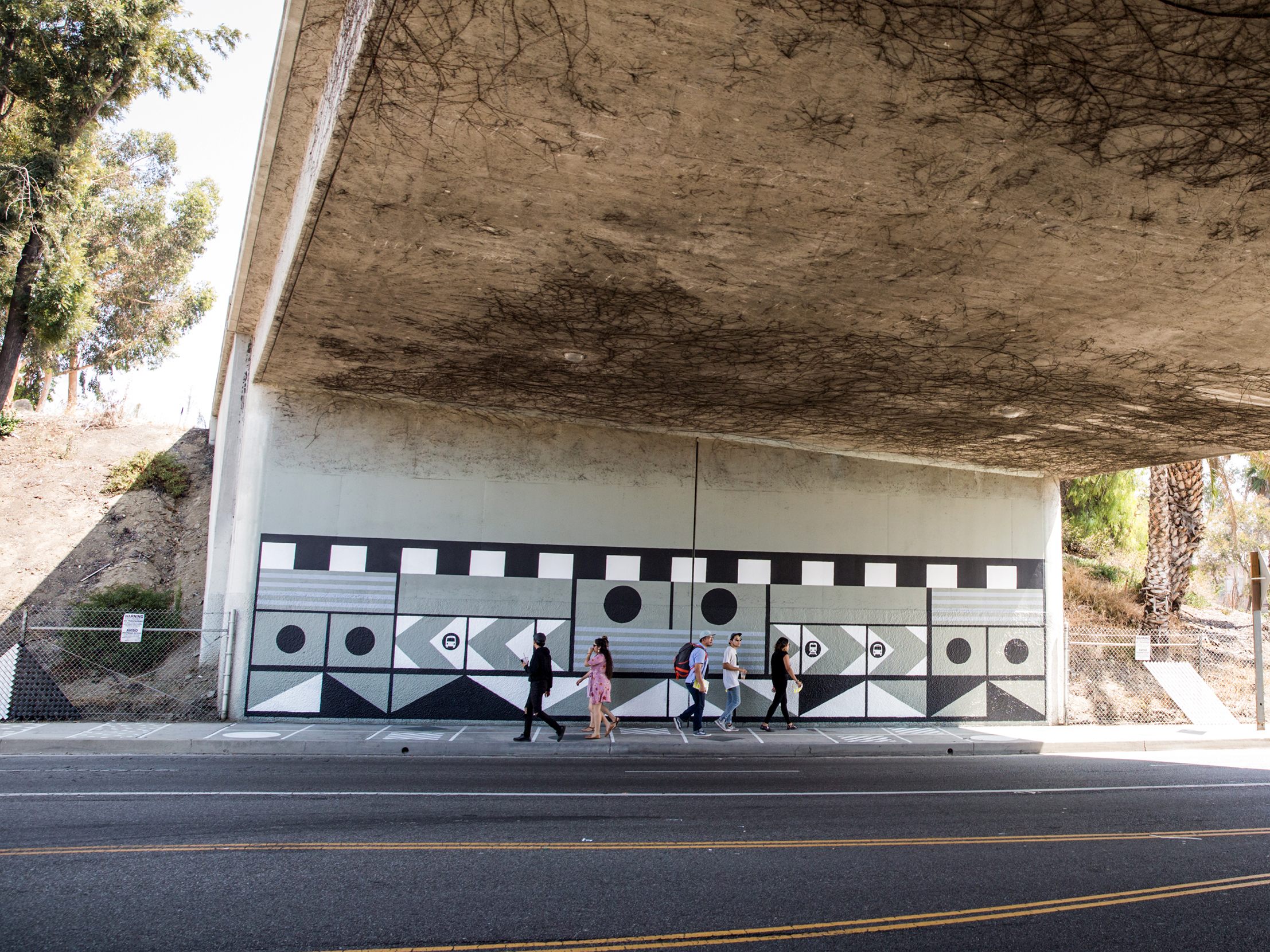 After: Murals on Underpass Walls, Sidewalk Patterning, New Fencing with Fence Weave