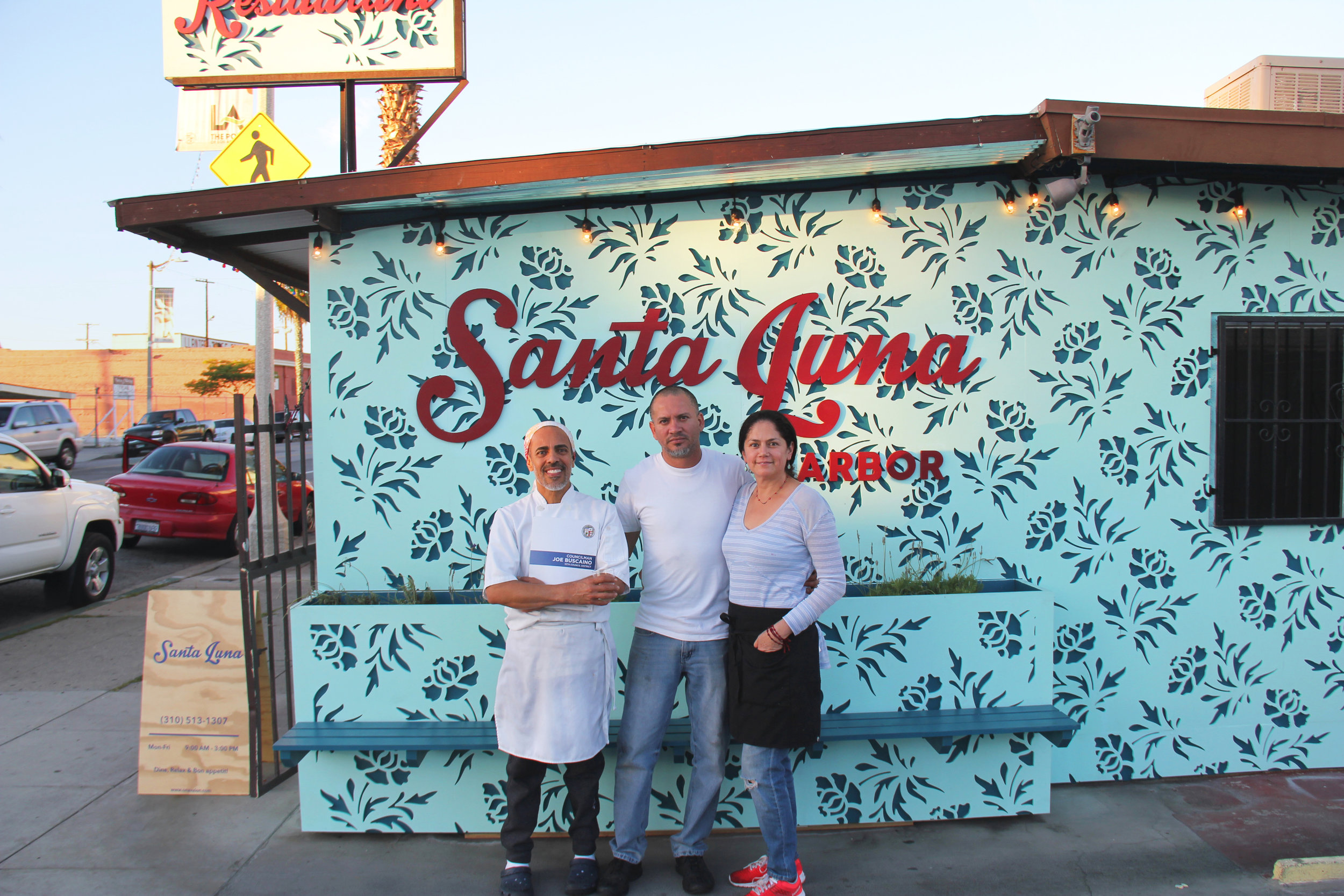 The owners of Santa Luna restaurant in Wilmington – Antonio, Jose, and Teresa – stand in front of their new exterior that was designed to match their vibrant interior. (This project was part of the On Avalon: Small Business Support Program.)