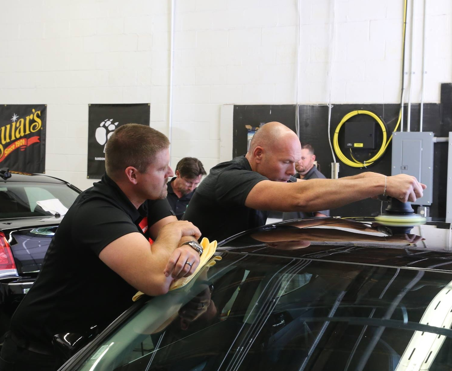 Brad McRae (owner) training with Rupes and Meguiars in 2017