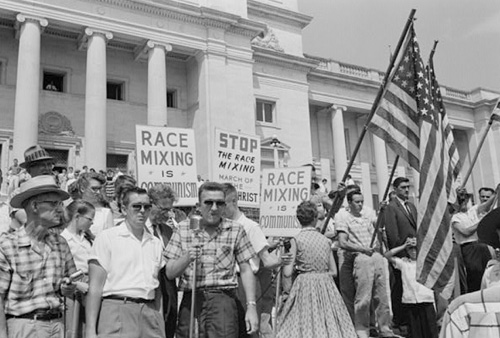 Hostile crowds protest the integration of schools in Topeka, KS (circa 1954)
