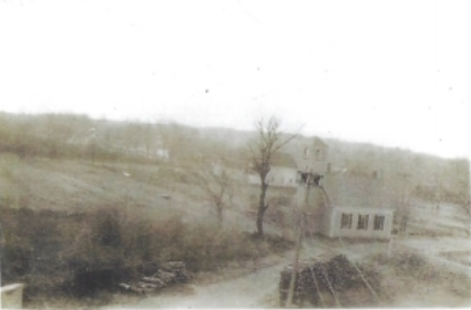 Photo of the South Main Street School likely taken from the top floor of Fitts Mill, facing south. Date unknown.