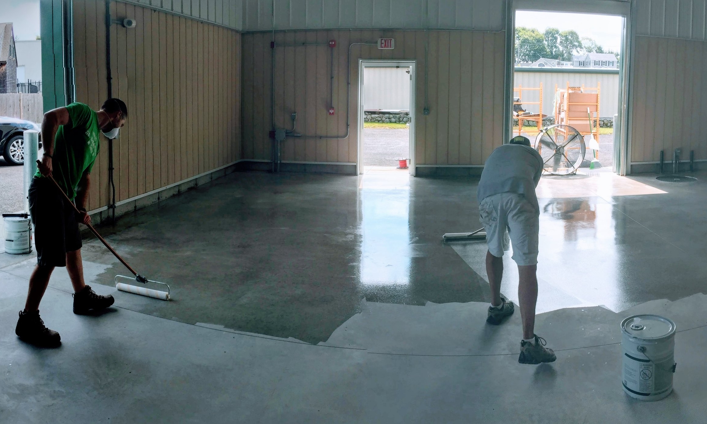 Brewers Matt and Kyle seal the floors in prep for our equipment's arrival.