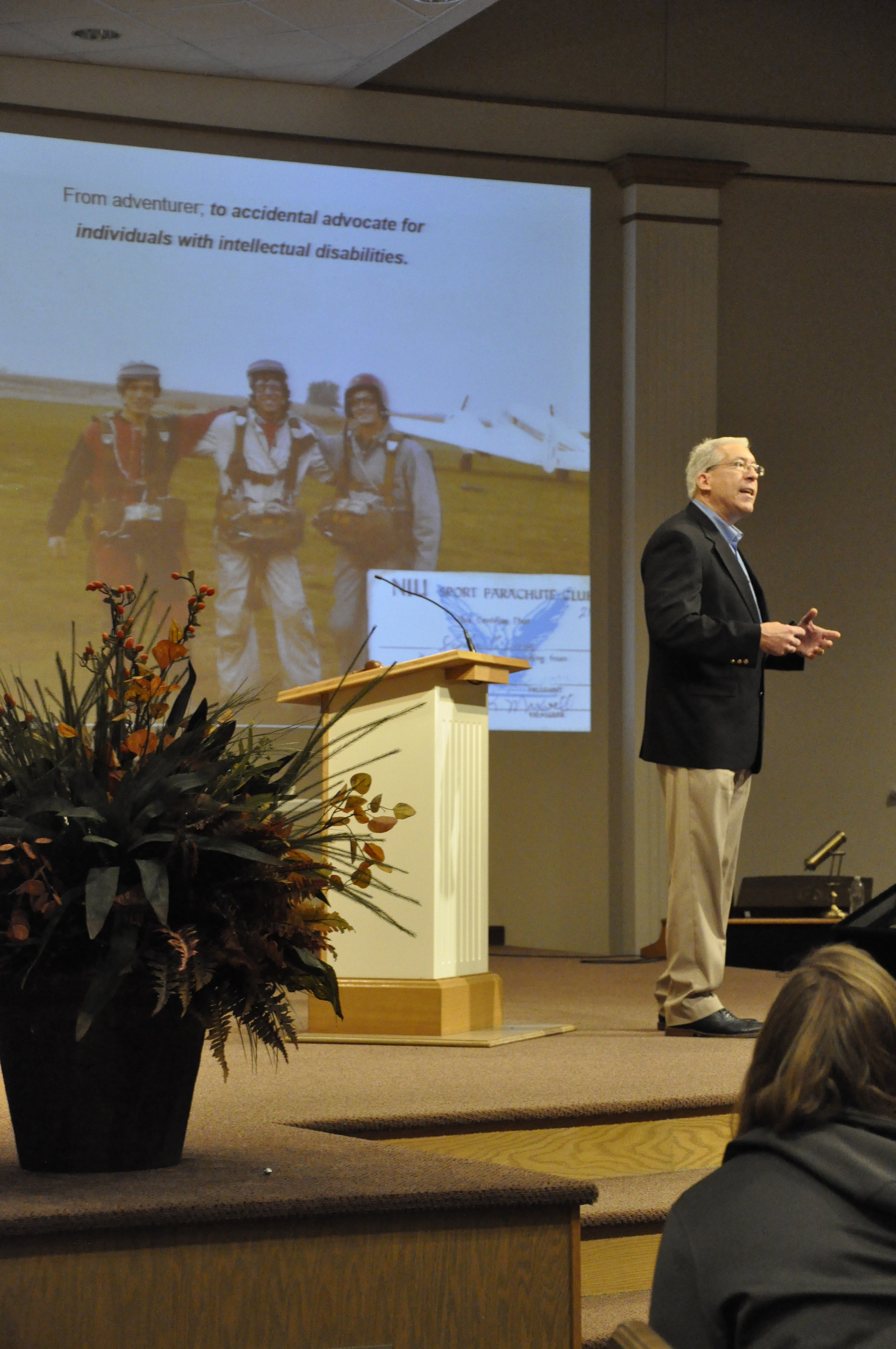 Pictured in the middle of the background photo and presenting on stage is Steve Cerve; from adventurer to accidental advocate.