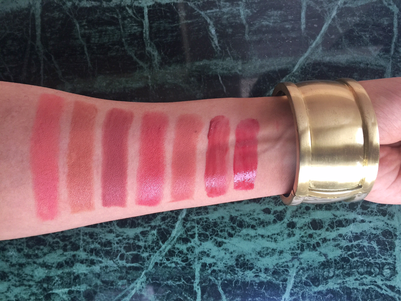 From left:  M.A.C Velvetease Lip Pencil in Frolic, Estée Lauder Victoria Beckham Lipstick in Brazilian Nude, Bobbi Brown Lipstick in Brown, Elizabeth Arden Ceramide Lipstick in Coral, Chanel Rouge Allure in Angelique, YSL Baby Doll Kiss & Blush in 10, Smashbox Be Legendary Long-Wear Lip Lacquer in Muted Raspberry.