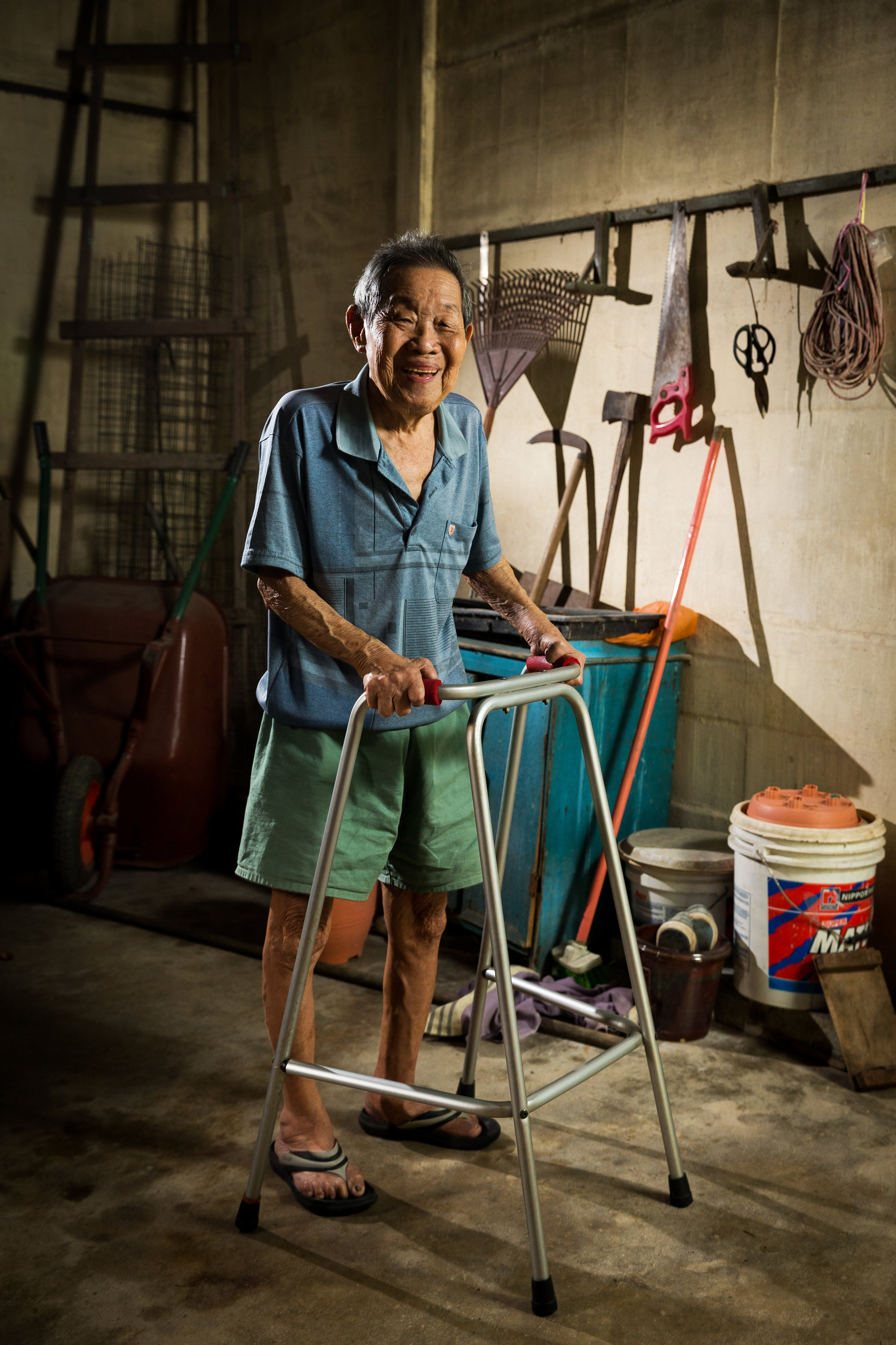 Ng Keng Chai uses the walker to move about. (photo by Mango Loke)