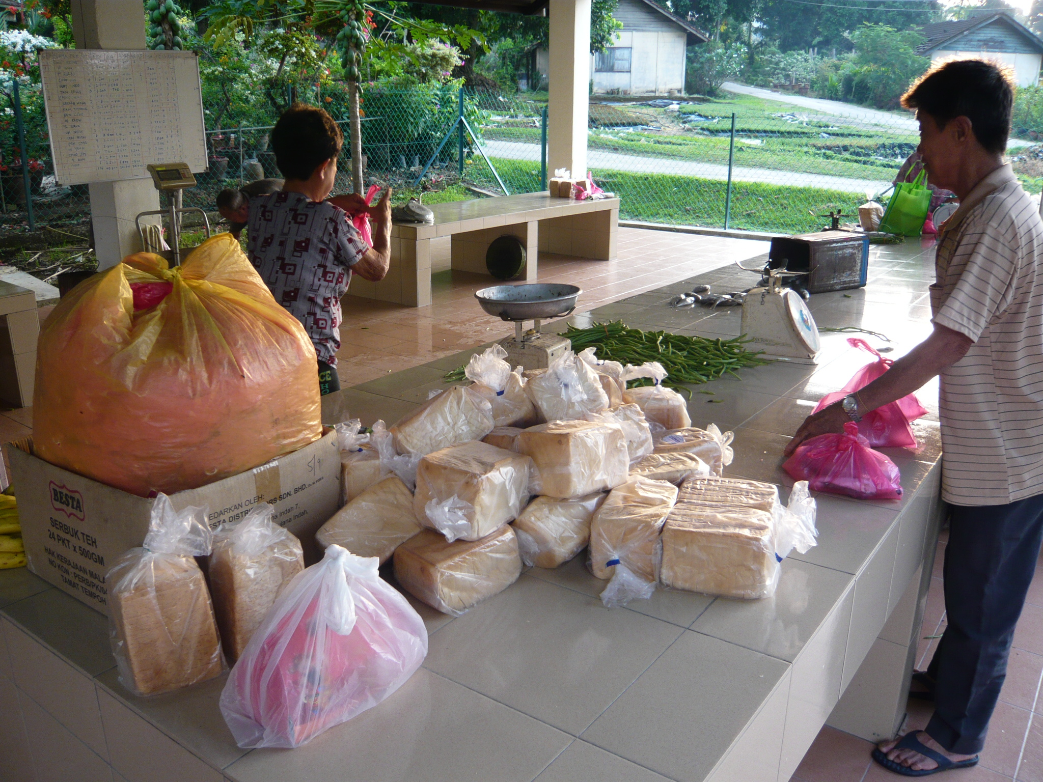 The section attendant allotting the rations for the residents living in the chalets.                               (photo by   Joshua Wong )