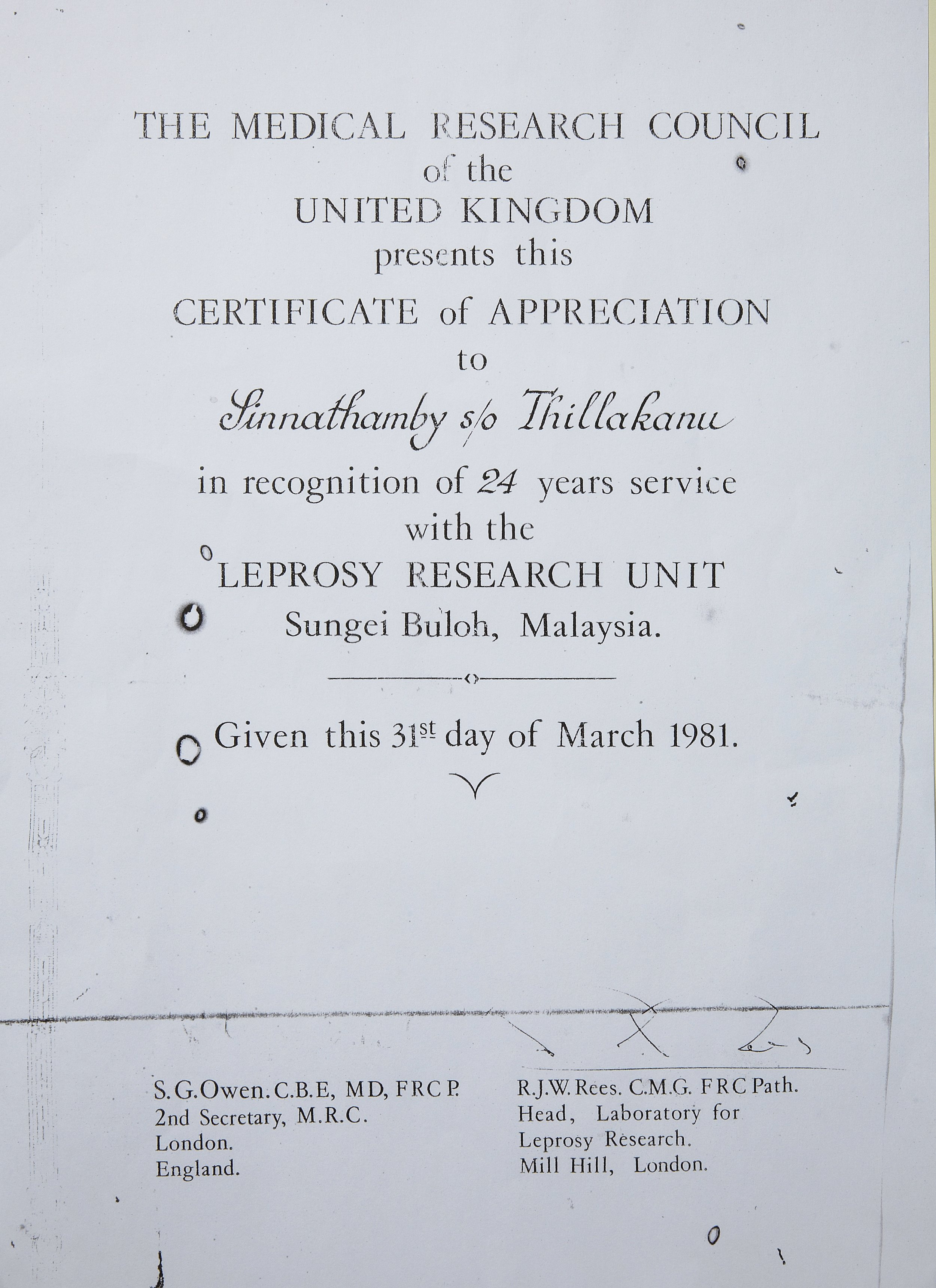 Sinnathamby's proudest possession is this certificate which he received from the U.K. (photoby Tan Ean Nee)