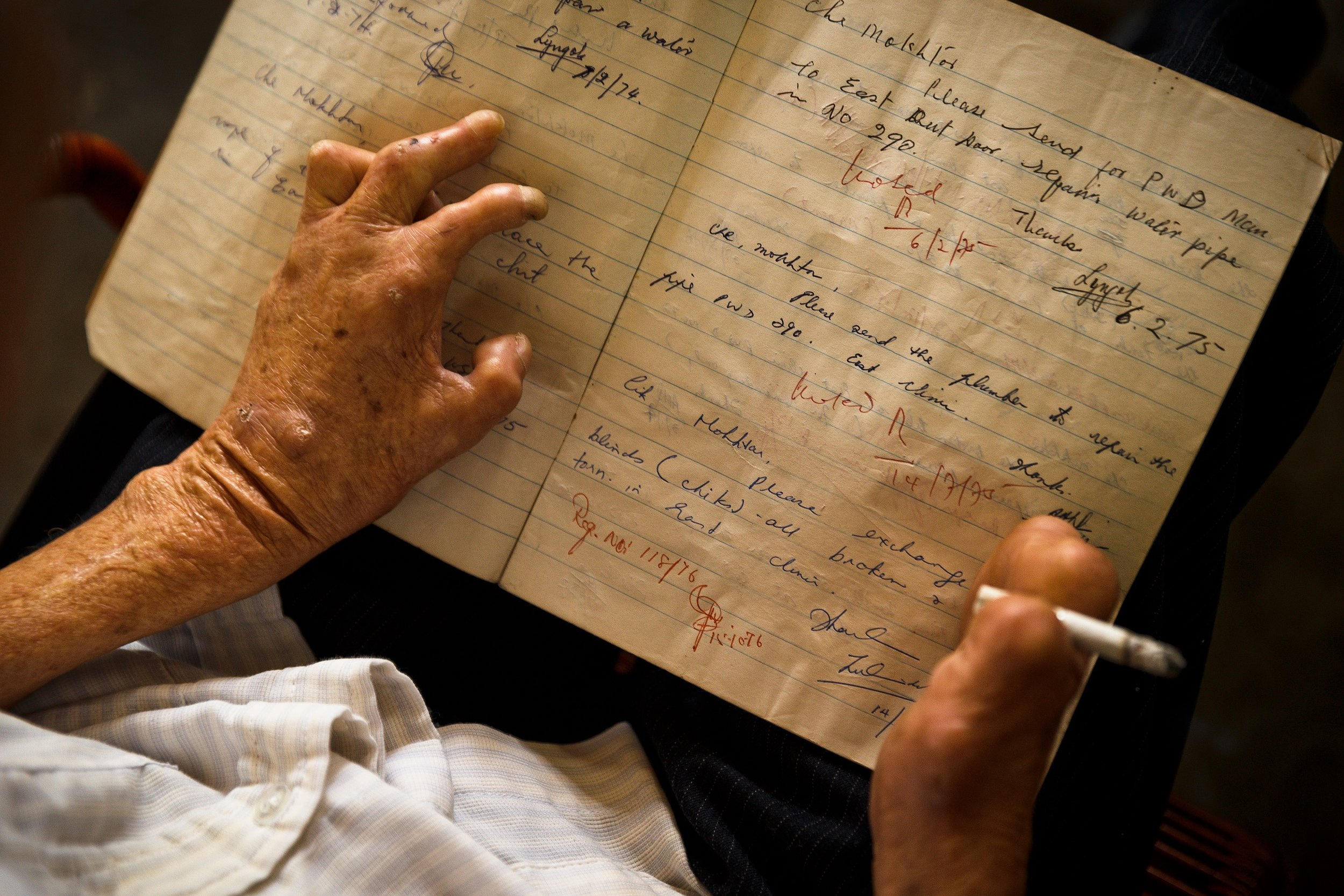 Leprosy has caused him to lose his fingers but he still manages to write. (photo by Mango Loke)
