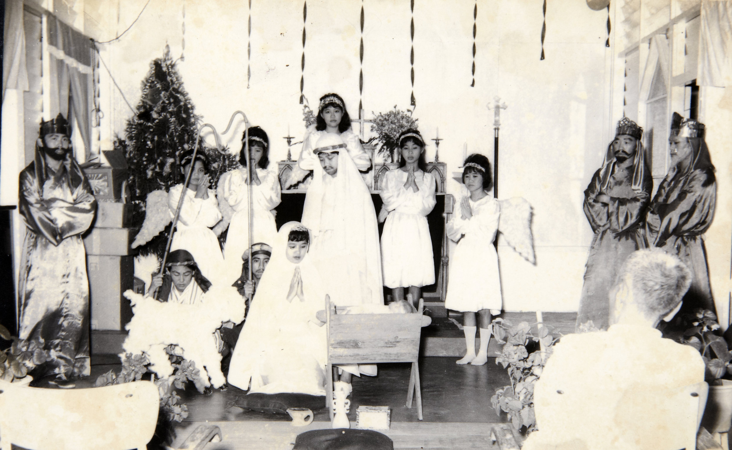The residents performing a play in the St. Lourdes Catholic Church. (photo courtesy of Law Seng Hoa)