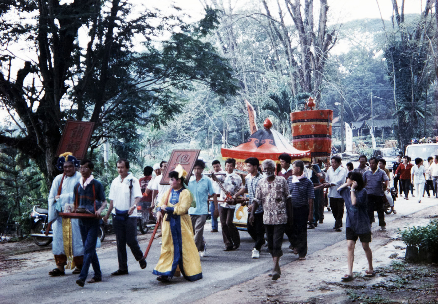 """A procession led by the """"Censer Master""""who is carrying the incense burner of the Taoist deity. (photo courtesy of Fuh Huey Kong)"""