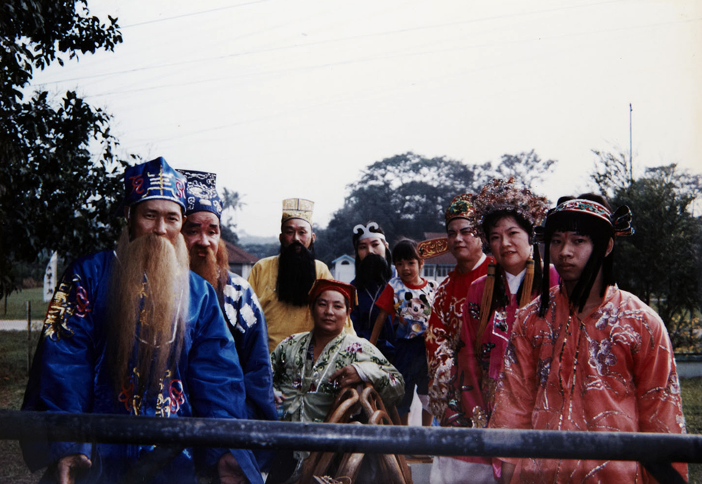Devotees dressed up as the Eight Immortals during a Fuh Huey Kong procession in the settlement. (photo courtesy of Fuh Huey Kong)