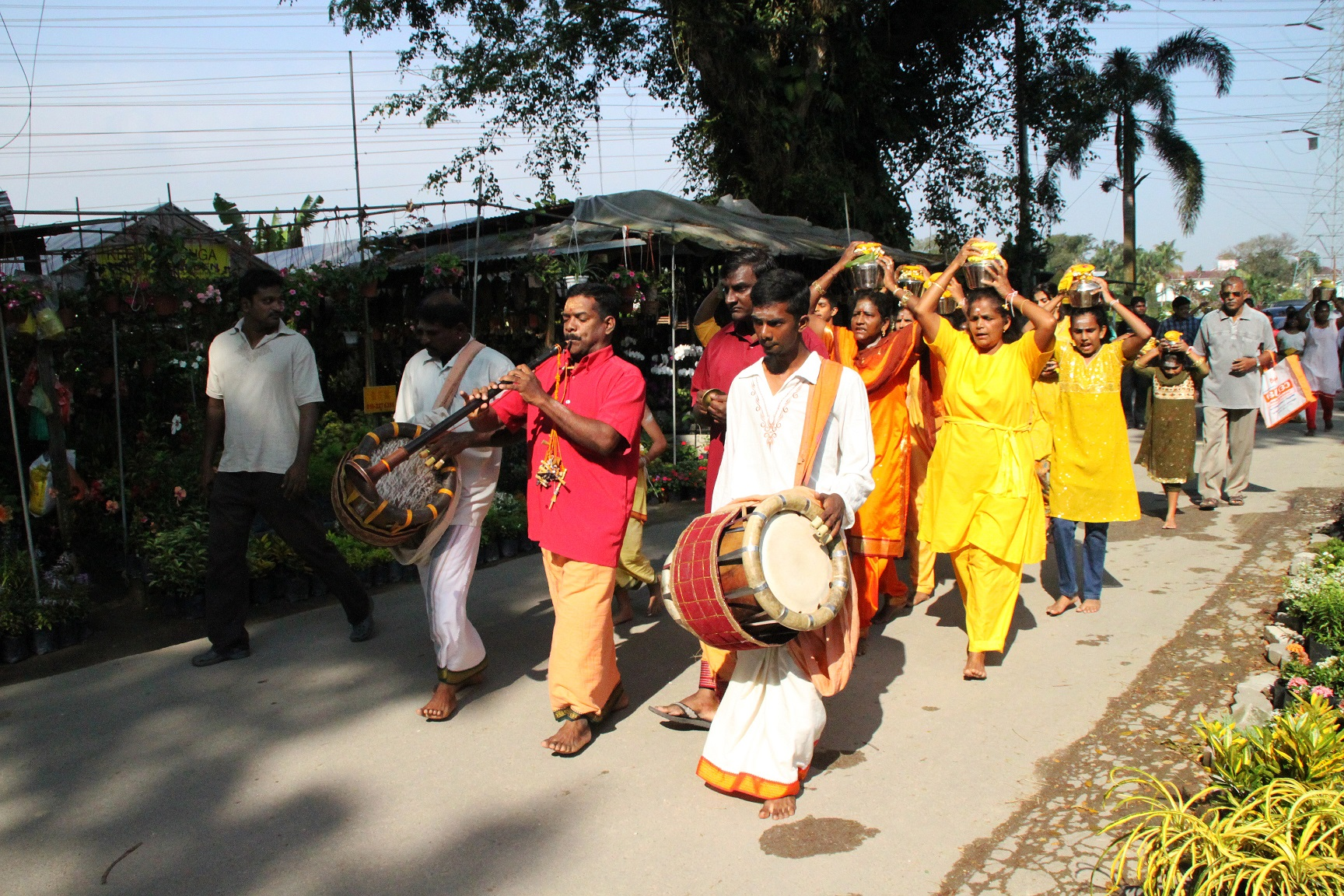 A procession by the Indians to celebrate Thaipusam in the settlement.    (photo by Tan Ean Nee)