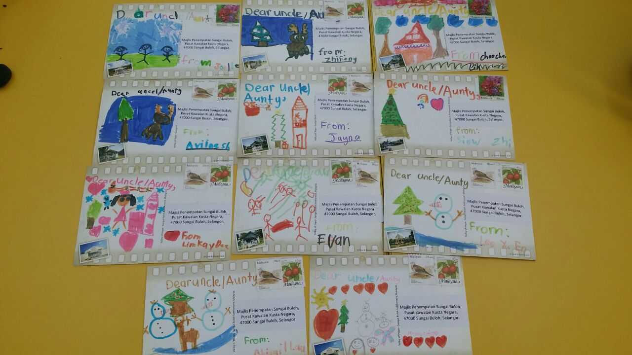 """Postcards sent by the children to the """"Heroes of the Valley of Hope"""". (photo by Yee Tyan)"""