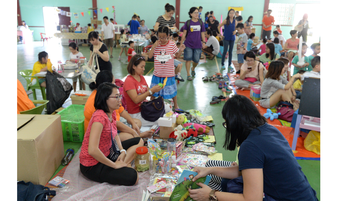 Children and their parents helping to generate funds for the Story Gallery. (Photo by Stanley Woo)