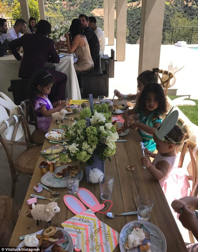 Kids enjoy Easter brunch at their own separate table while the adults look on