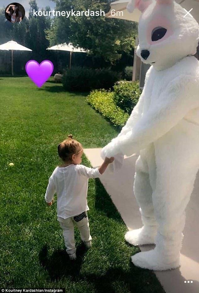 The Easter bunny/Uncle Kanye lends a hand during the massive egg hunt