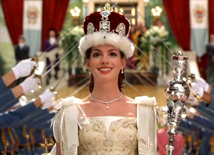 Pictured: Hathaway in full TPD glory as a  literal  queen