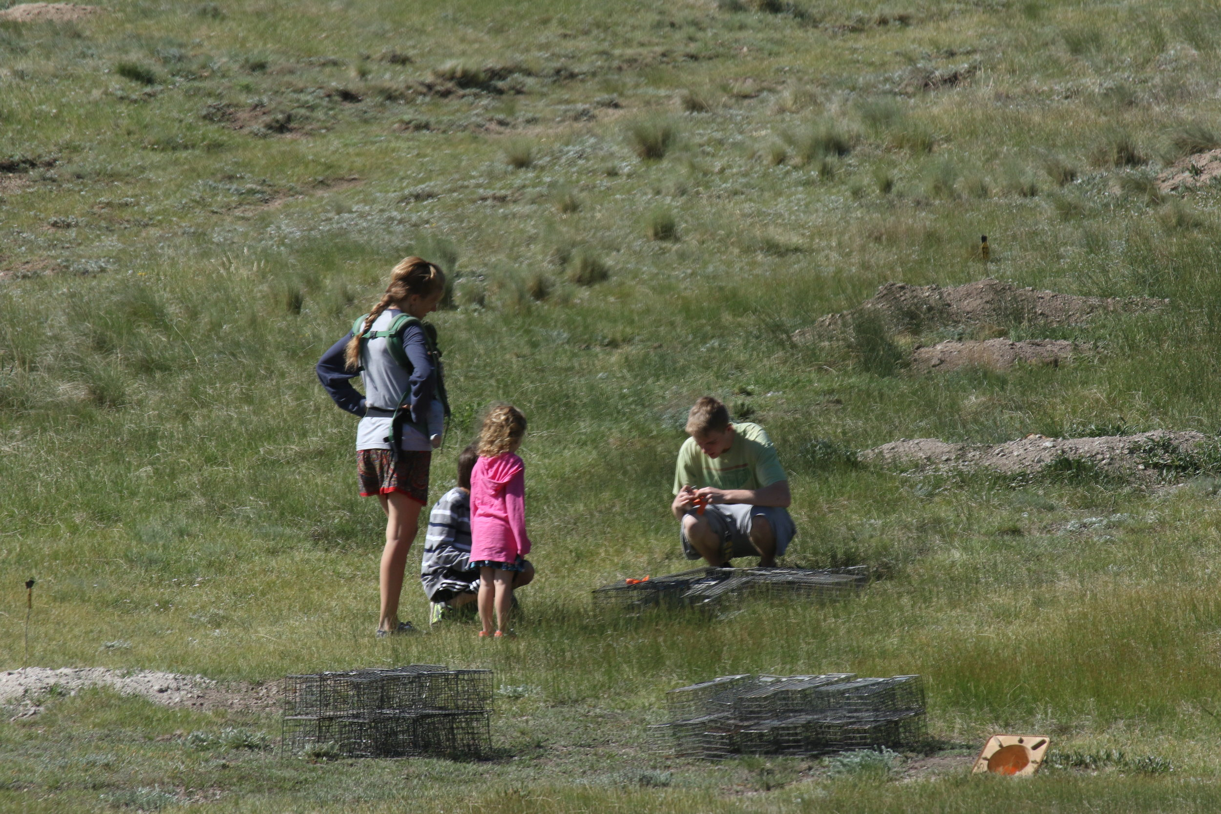 Squaddie Jimmy engages with a passing family. Speaking with hikers and park visitors gives us the opportunity to explain not only our research but the importance of prairie dogs on the landscape.  ©MRR 2017