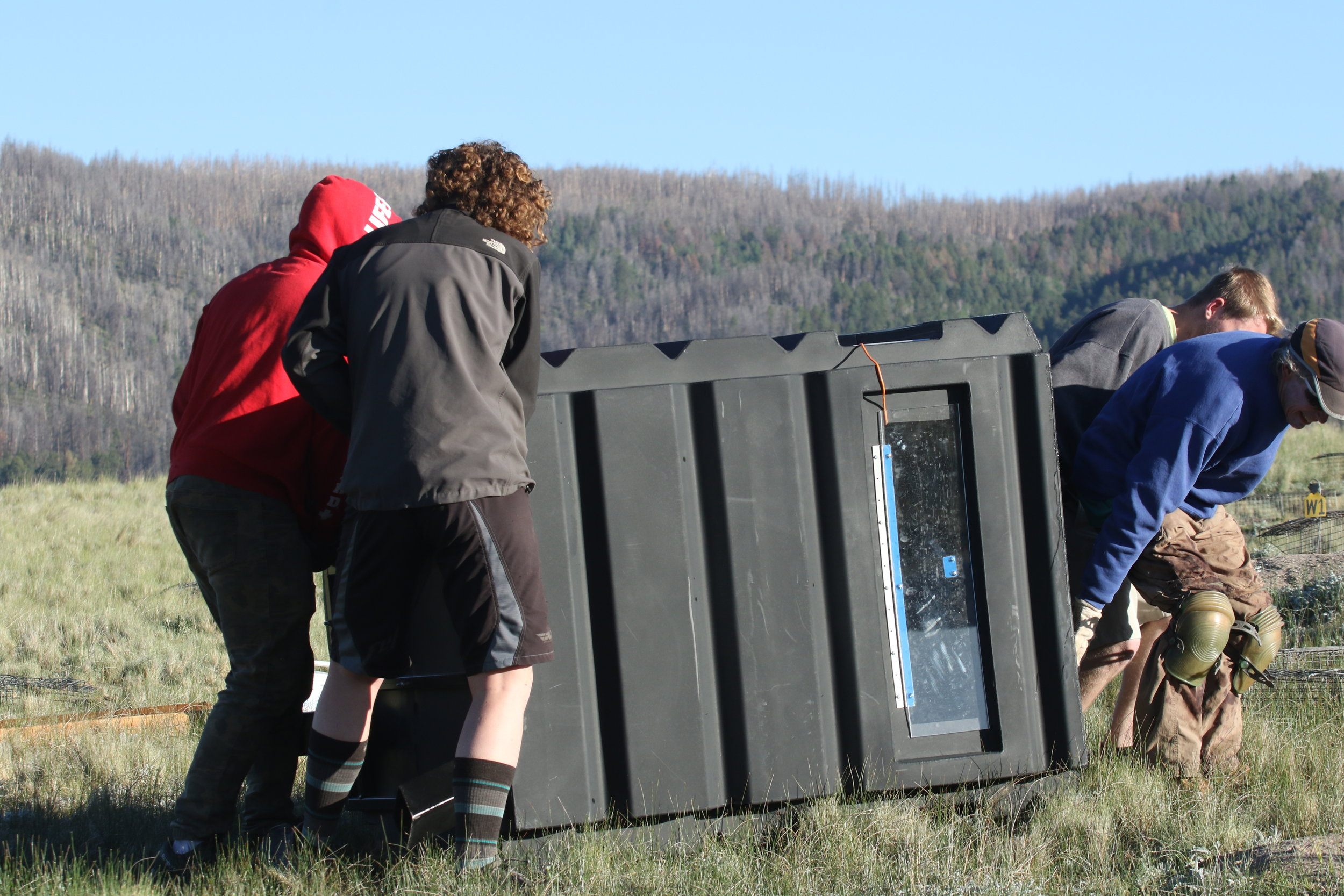 The squad works together to relocate an observation blind.  ©MRR 2017