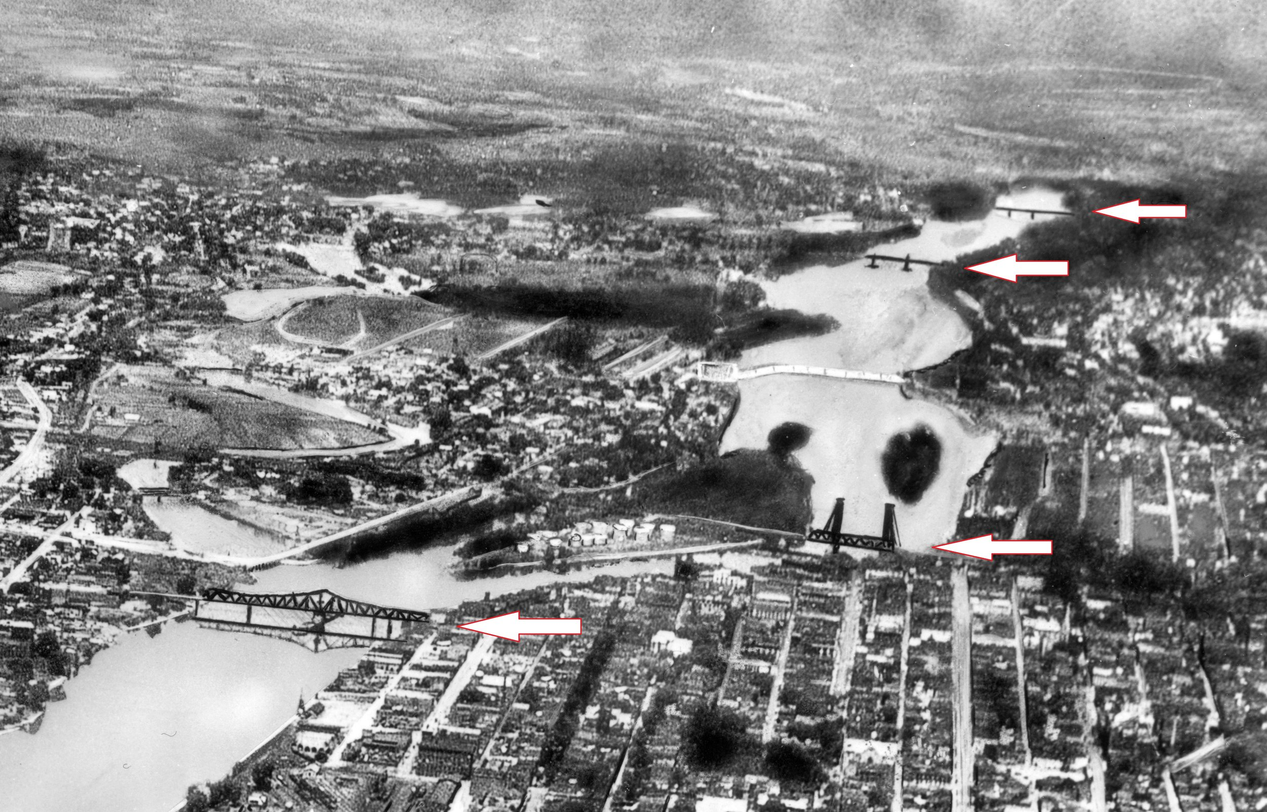 This aerial view of the Hudson Valley looking north dates from about 1930 and shows four of the bridges that cross the river within Troy's city limits. Do you know which ones are not there yet? Top to bottom – Waterford/Troy (Lansingburgh; 112th Street (Troy/Cohoes); Green Island/Troy; and Congress Street bridge. All of the bridges shown have either been replaced with newer bridges or had a lot of work done on them in recent years.