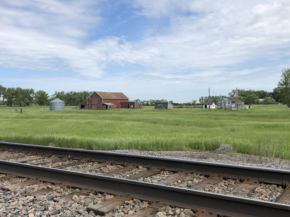 Troy  Farm with Railroad tracks in front.png
