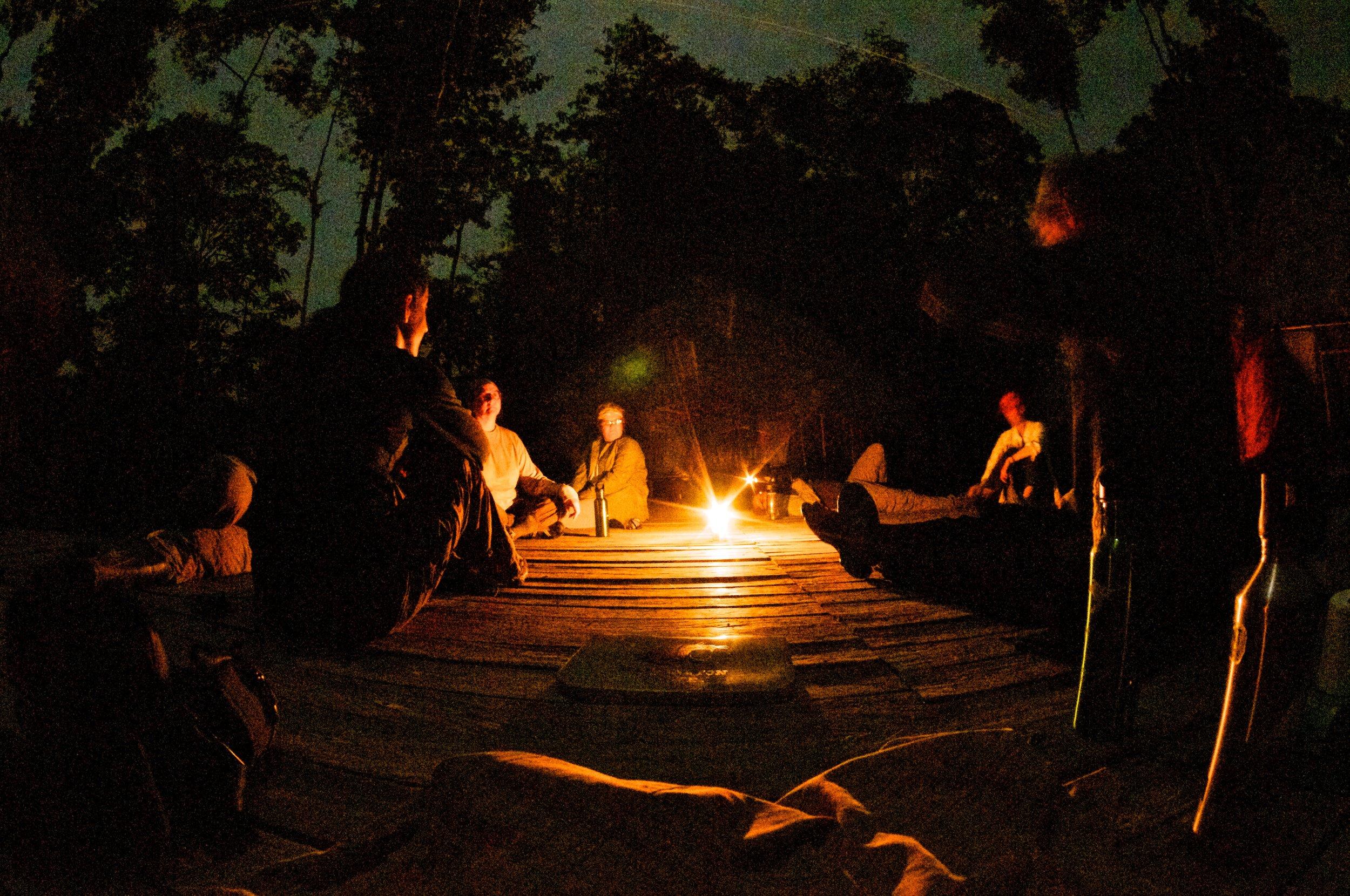 Evening conversation, deep in the Amazon rainforest, Ecuador.