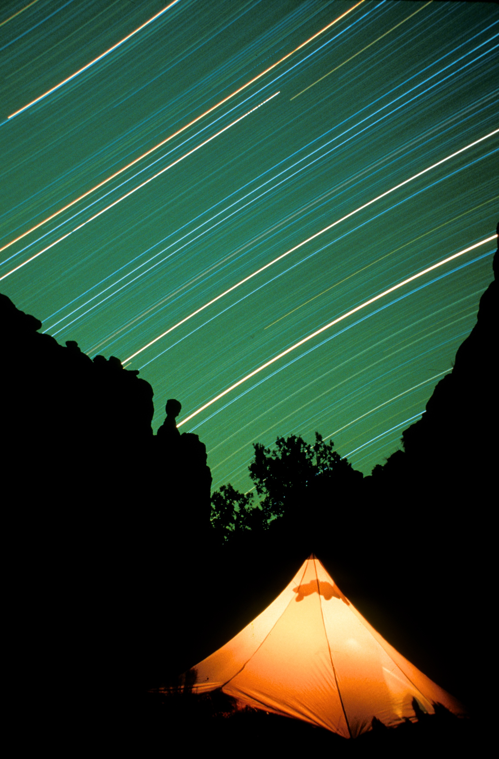 Star trails over tent, Owl Canyon, Utah.