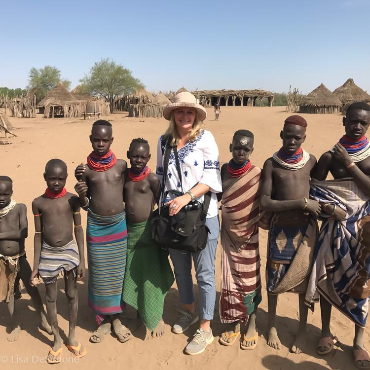 Attracting a crowd of Kara children.