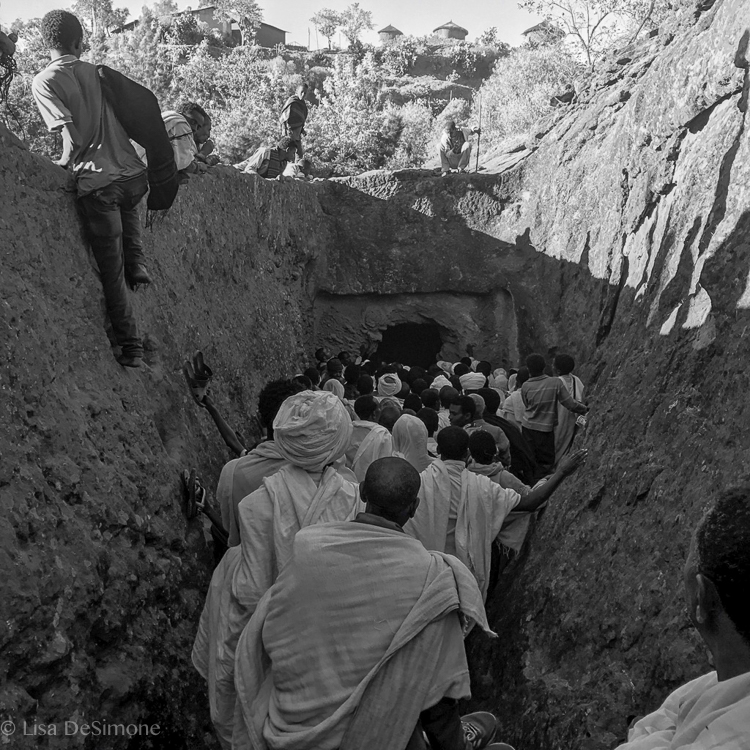 Pilgrims entering one of the many passageways that connect the churches of Lalibela.