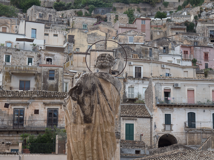A saint looks over the city of Modica